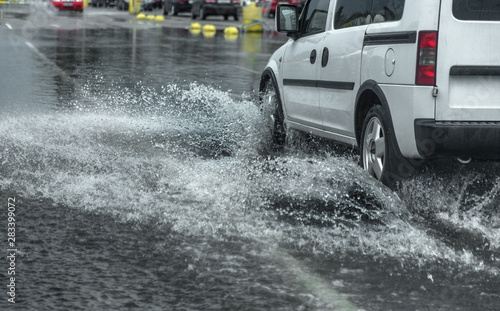 Fotografie, Obraz Odessa, Ukraine - August 9, 2019: driving car on flooded road during flood caused by torrential rains