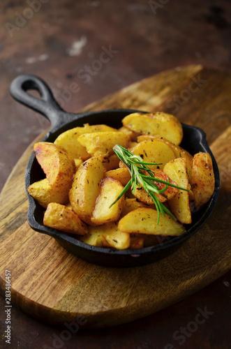 Slika na platnu Patatas Bravas, traditional Spanish tapas, baked potatoes