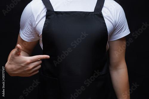 Canvas Print Closeup strong man wearing black apron.