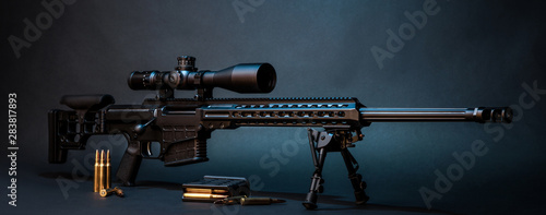 Fotografie, Obraz Modern powerful sniper rifle with a telescopic sight mounted on a bipod