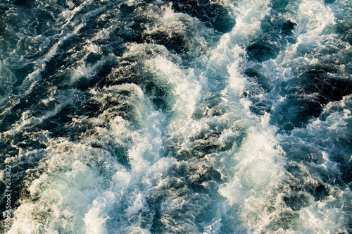 Fotografie, Obraz Blue bubbling water. whirlpools with foam and lamb.