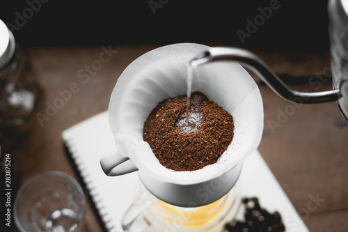 Tableau sur Toile Drip Coffee Black coffee brewed in low light in the house