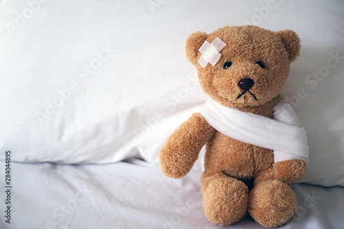 Wallpaper Mural Teddy bear and bandage. Injury concept