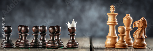 Small Courageous Pawn With Fake Paper Crown Costume Leading Others Into Battle Fototapet