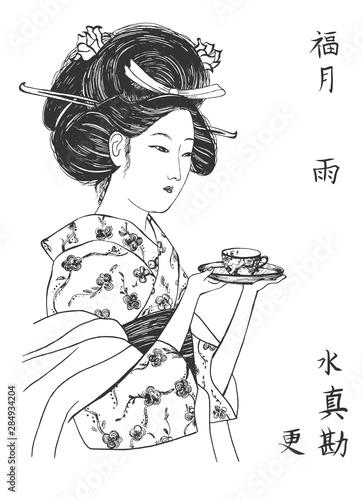 Fotografia Japanese geisha in kimono with teacup