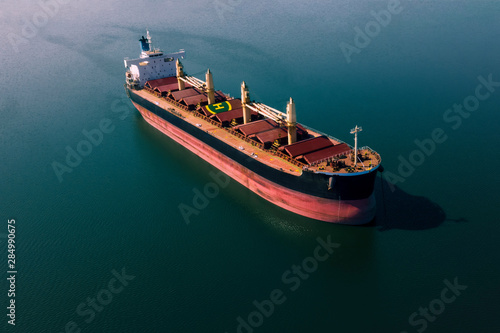 Wallpaper Mural Shipping cargo to harbor by ship