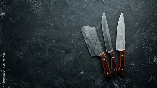 Fotografie, Obraz Kitchen old knife on a black stone table