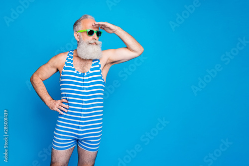 Portrait of his he nice attractive content sportive trendy stylish serious gray-haired man looking far away meet friend isolated over bright vivid shine turquoise blue green background