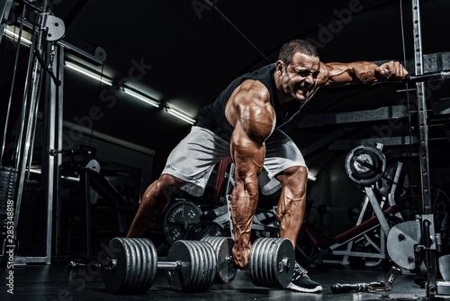 Canvas Print Hard Core Bodybuilding. Bodybuilder ready to lift heavy dumbbell