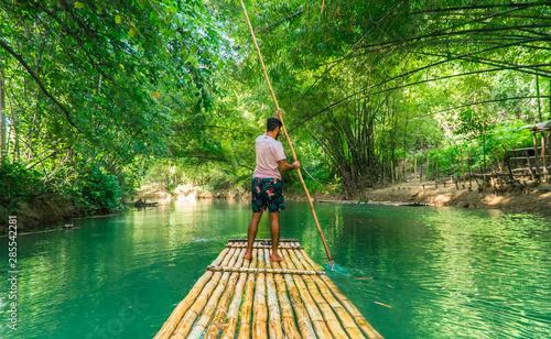 Photo Man rowing bamboo raft, Martha Brae