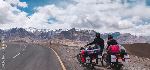 Canvas Print Two young bikers stopping by a great Himalayan view en route Ladakh