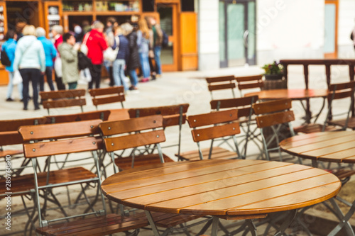Fototapeta Wooden tables in outdoor cafe, Karlovy Vary