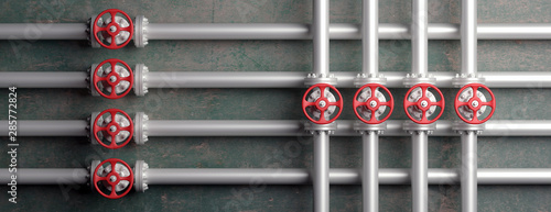 Canvas Industrial pipelines and valves with red wheels on gray wall background