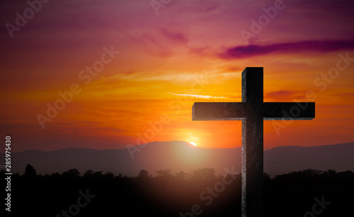 Fotografie, Obraz Silhouette of crucifix cross time for background