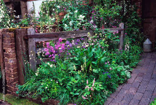 'The Old Gate' garden farmhouse garden with wild natural planting of flowers Fotobehang