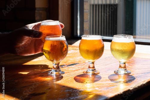 Obraz na plátně Tasting beer samples from a flight