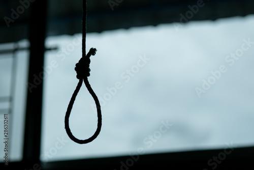 Silhouette of Hangman's noose knot. commit suicide concept. Fototapeta