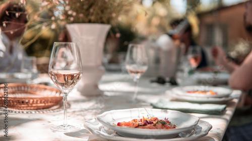 Vászonkép Provencal table with rosé wine