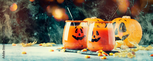 Fotografie, Obraz Halloween composition with festive red bloody drink and smiling pumpkins, with s