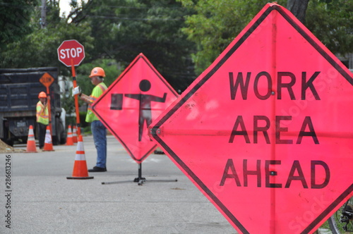 Construction Work Sign, Flaggers and Cones