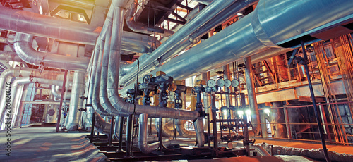 Fotografia, Obraz Equipment, cables and piping as found inside of a modern industrial power plant