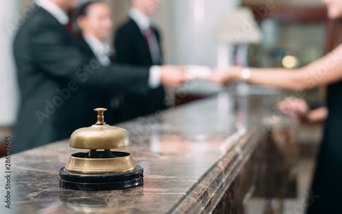 Fotografiet Picture of guests getting key card in hotel.