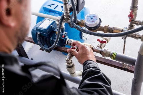 Technician checking water system nodes. Fototapeta