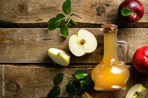 Apple cider in glass jar, wood background Fototapeta