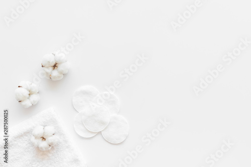 Cotton flowers with pads on white background top view mock up