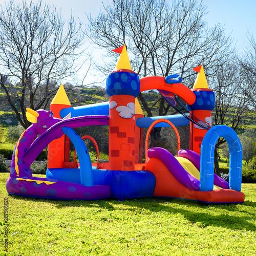 Obraz na płótnie Inflatable castle outdoor at sunny summer day.