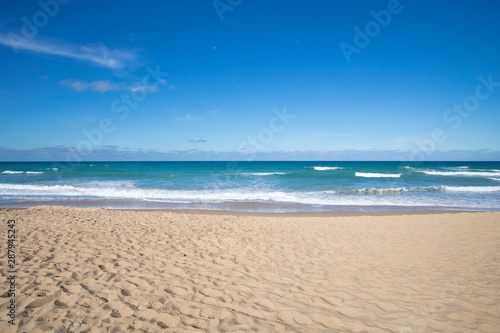 front view of seashore of Palmar Beach with sand, turquoise ocean water and hori Fotobehang