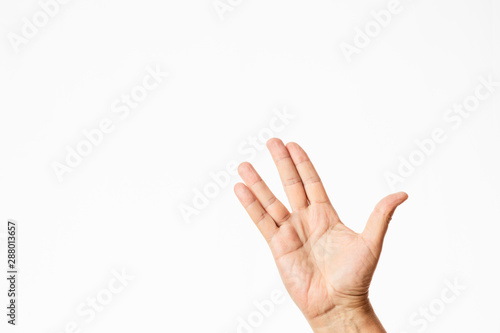 male hand waving in a trekkie style isolated in white background Fototapeta