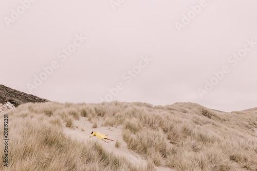 Girl in yellow dress on dunes