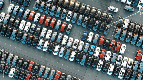 Fotografie, Obraz tight coloured car rows on parking area vertical upper view