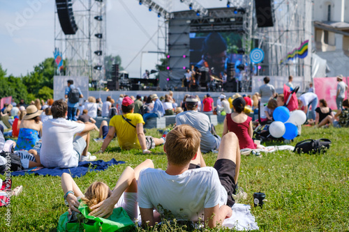 Fotografija Couple is watching concert at open air music festival