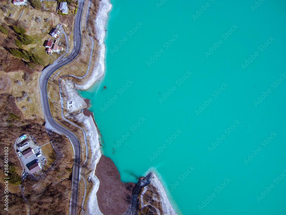 Aerial zenital view of amazing colorful Barcis green lake in Friuli Venezia Giulia. Nature trekking destinations and Mountain tourism icon