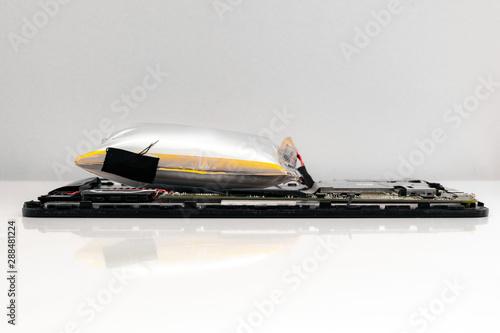 Obraz na płótnie damaged swollen Li-polymer battery in tablet