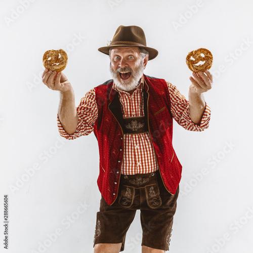 Portrait of Oktoberfest senior man in hat, wearing the traditional Bavarian clothes Fototapete