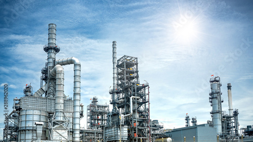 Fotografia Close up Industrial view at oil refinery plant form industry zone with sunrise a