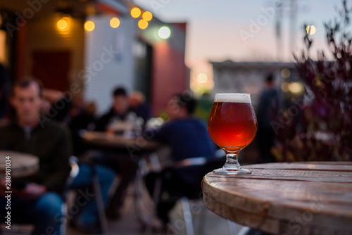 amber beer in tulip glass, craft beer on the patio, patio table with beer, patio фототапет