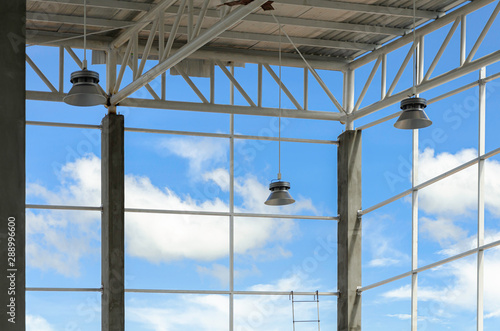 Stampa su Tela led high bay lights installed in warehouses Behind the scenes sky and clouds, Tr