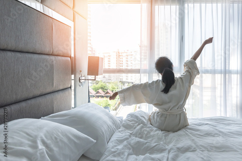 Canvas Print Work-life quality balance concept with lazy lifestyle of Asian girl on bed relax
