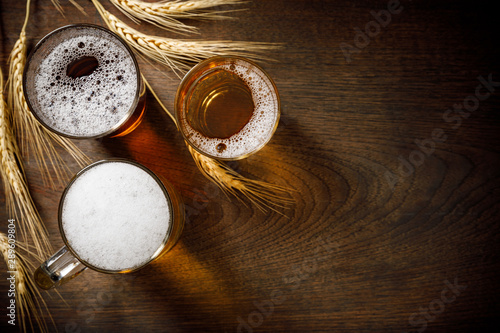 Three Glasses of Light Beer with wheat on the bar counter, copy space for your t фототапет