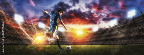 Fotografia Soccer players in action on sunset stadium background