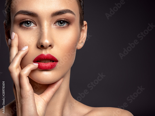 Stampa su Tela Beautiful woman with bright make-up and red lips.