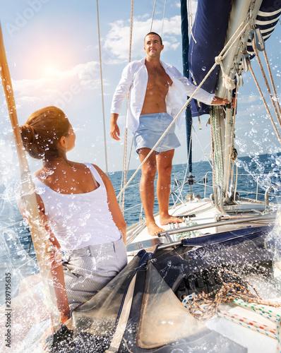 Stampa su Tela Man on sailboat with woman