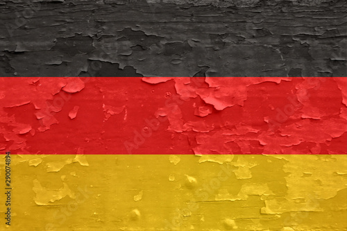 Wallpaper Mural Germany flag on old peeled wooden surface.