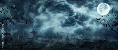Fotografia Zombie Rising Out Of A Graveyard cemetery In Spooky scary dark Night full moon bats on tree