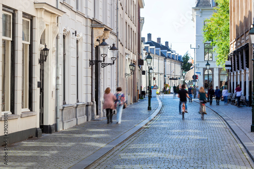 Foto Street with historical buildings and motion blur pedestrians