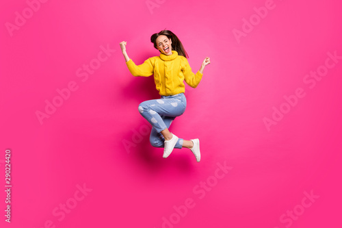 Fotografija Full size photo of excited girl with her eyes closed jumping raising fists screa